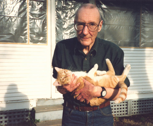 William S. Burroughs holding his cat Ginger