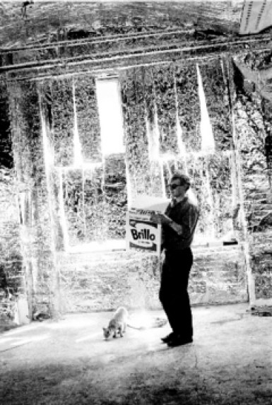 Andy Warhol with cat in studio