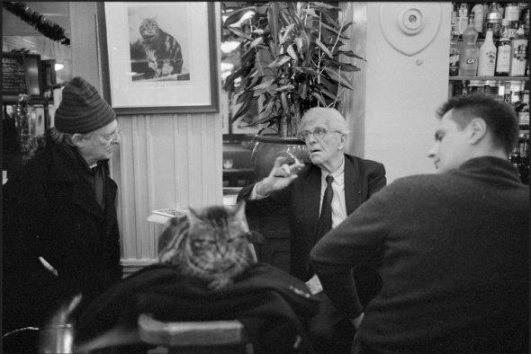 """Café """"Le Sélect"""", Montparnasse. Henri CHAPIER with his cat, 2007, Richard Kalvar"""