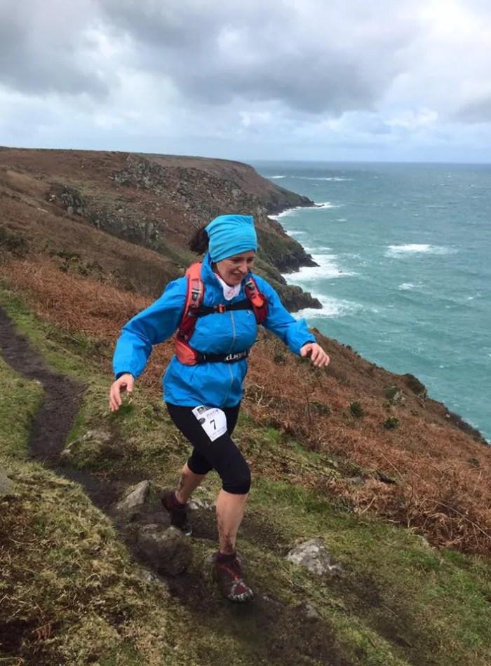 Woman running Cousin Jack Classic coastpath
