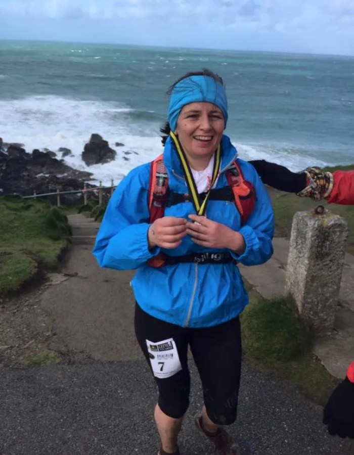 Woman runner with medal from Cousin Jack Classic