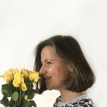 Woman smelling yellow roses