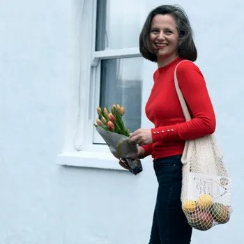 Woman walking holding tulips
