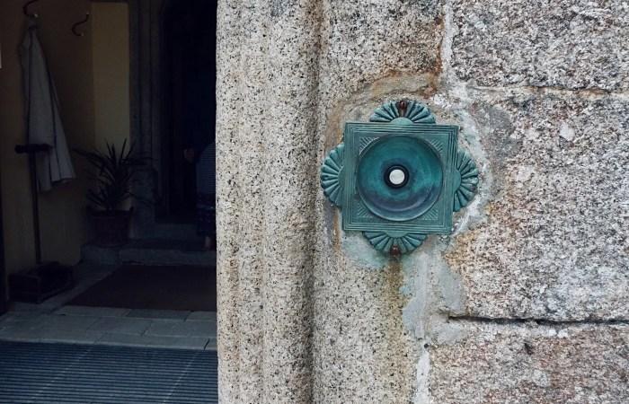 Green vintage doorbell on a wall