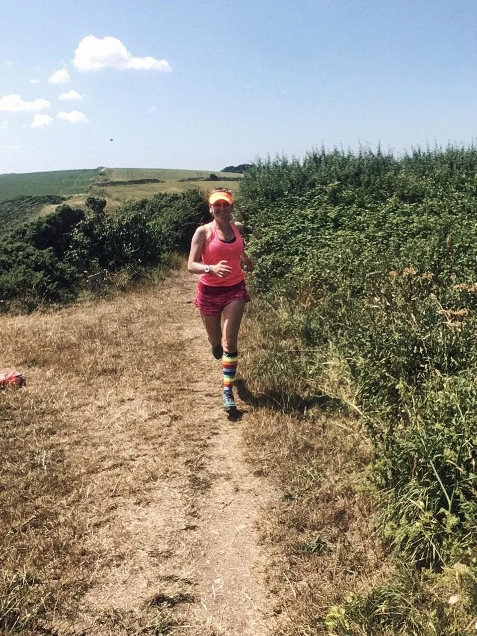 Woman Running Wearing Pink