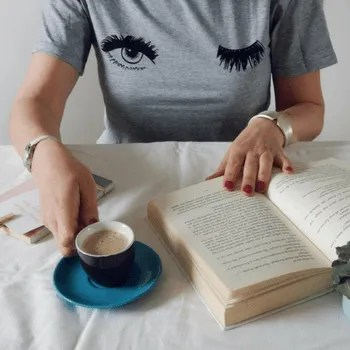 woman with espresso and book