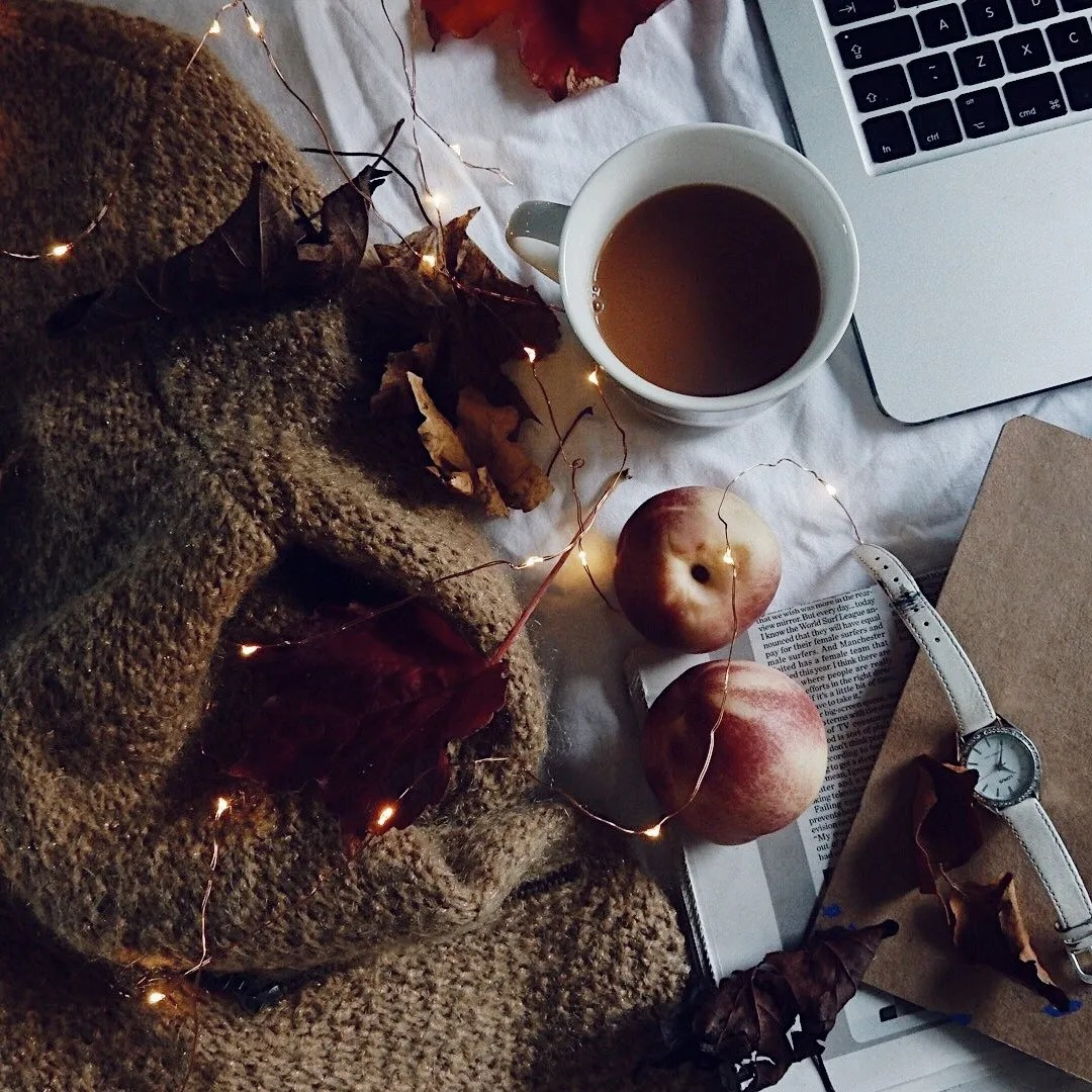 Tea and laptop with fairy lights