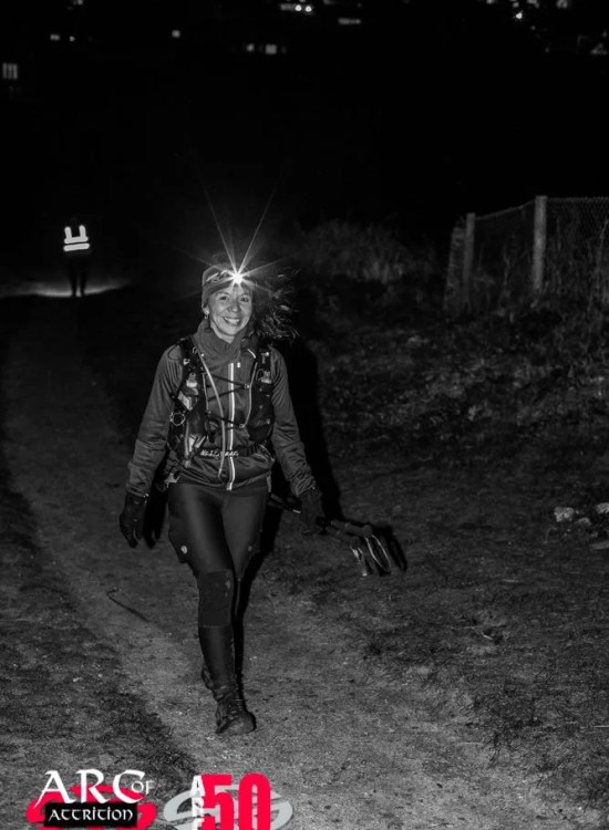 Lady walking at night head torch