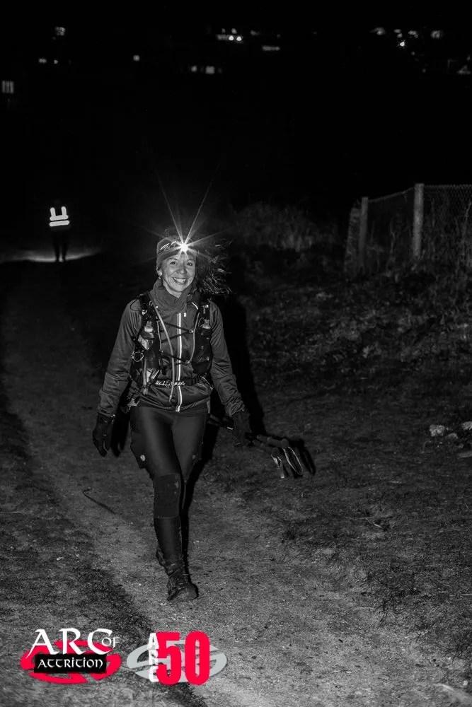 Lady walking at night head torch