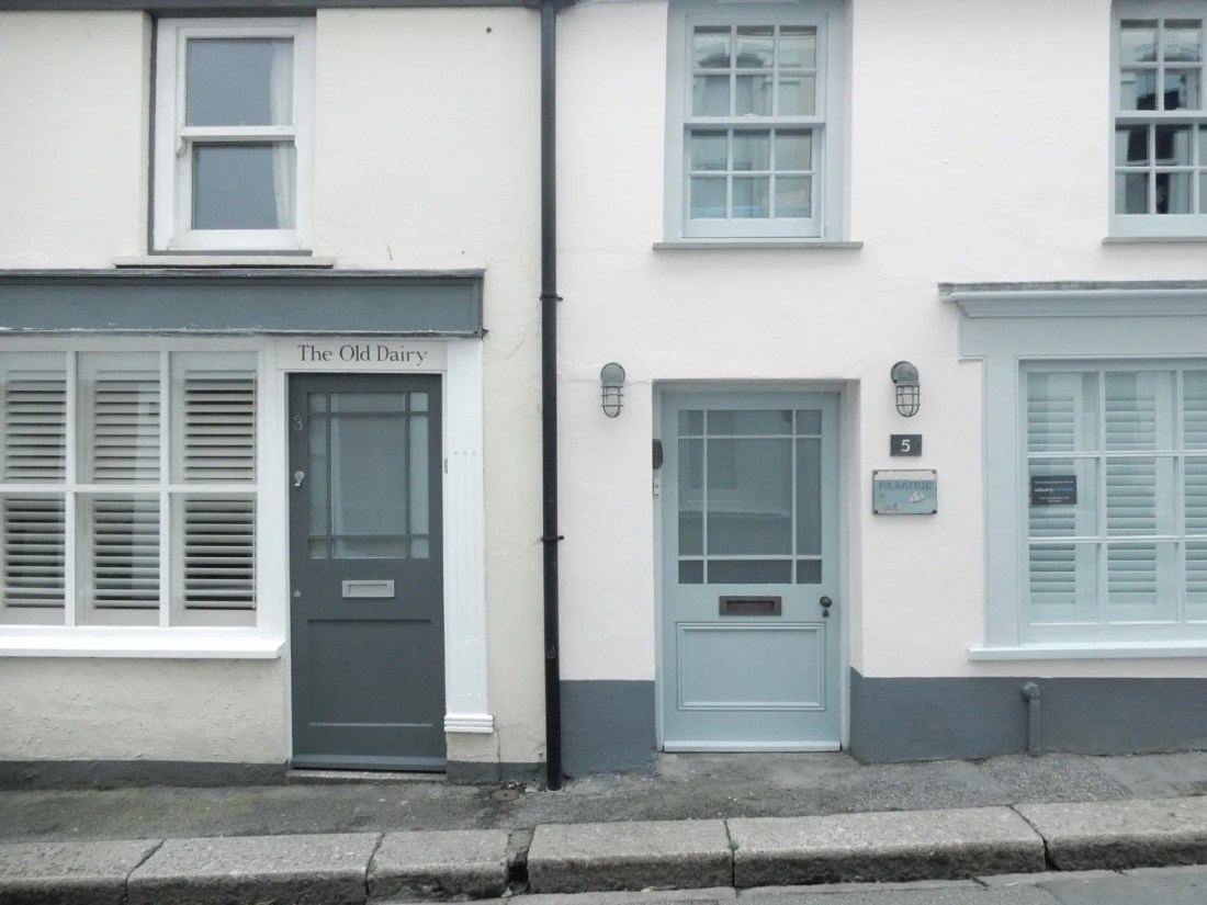 two doors and windows on a house