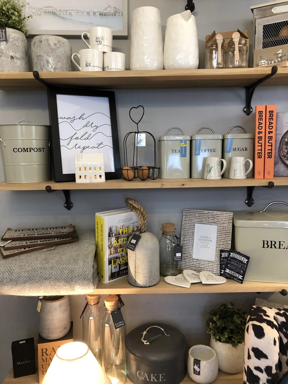 Shelves with books, cups and storage items