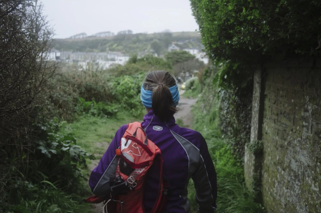 Lady coast path running mental health