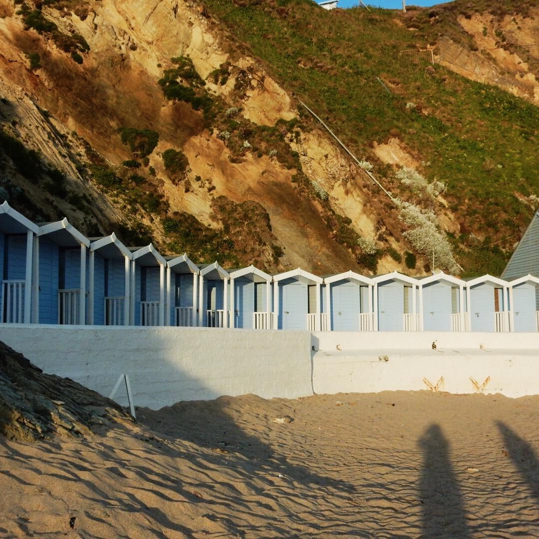 Blue Beach Huts at Lusty Glaze