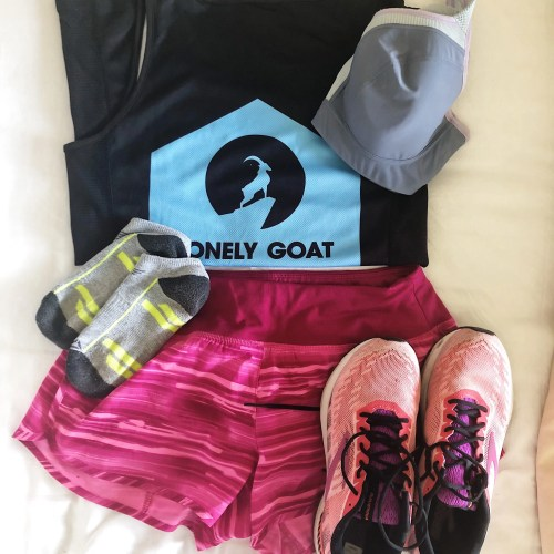 Running kit laid out on a bed