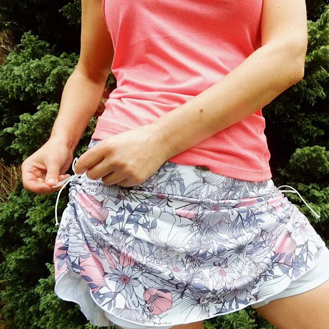 Woman fastening side of running skirt