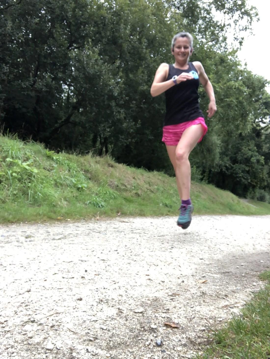 Woman running Pentewan Trail