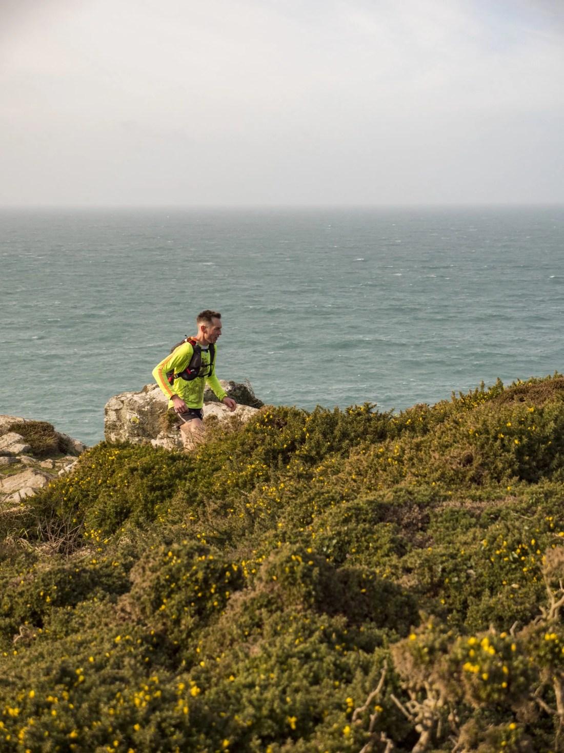 Male Trail runner coastpath Arc of Attrition