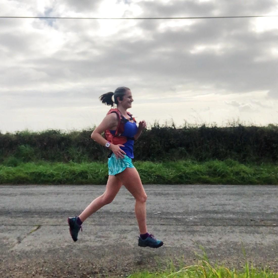 Woman start running mid stride road