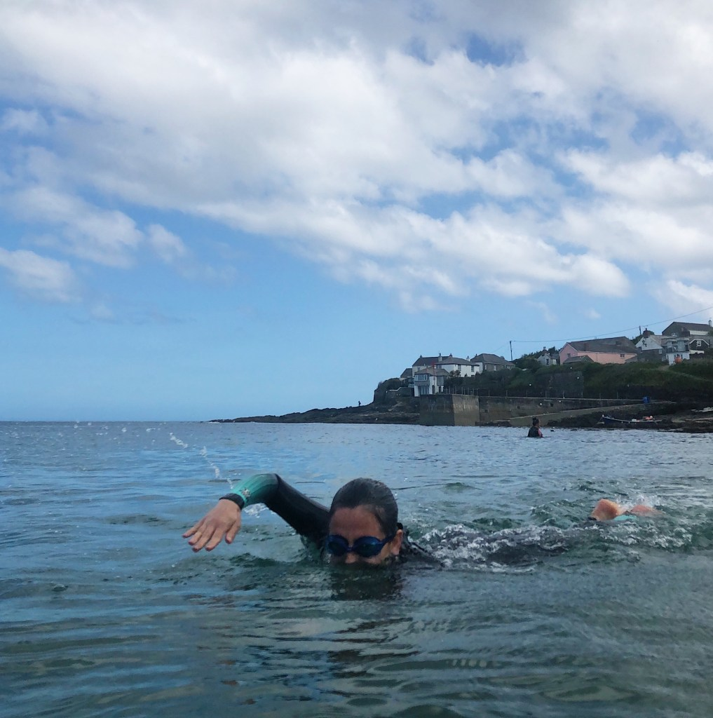 Woman sea swimming in a wetsuit