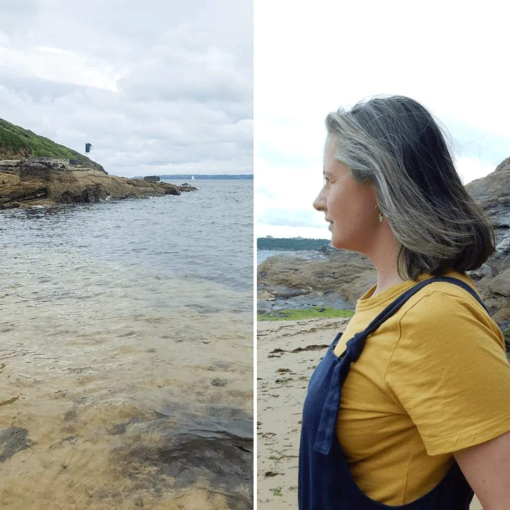 Woman side profile staring out to sea.