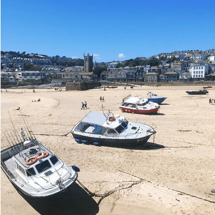 Boats resting on the sand at St Ives