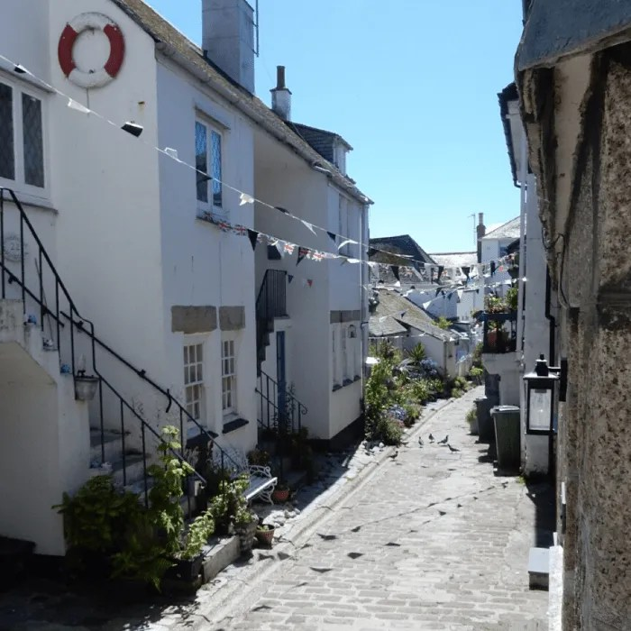 A cobbled street in St Ives with bunting