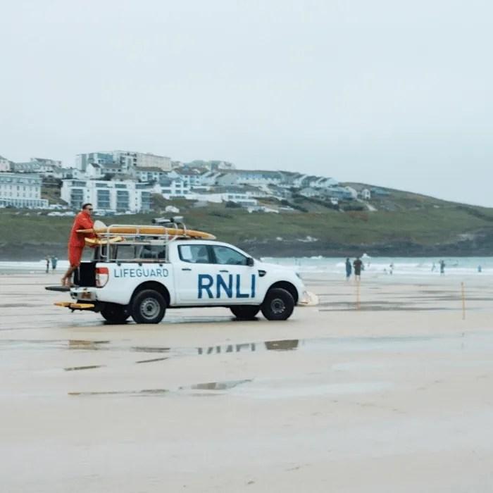 RNLI patrol and lifeguard on Fistral Beach
