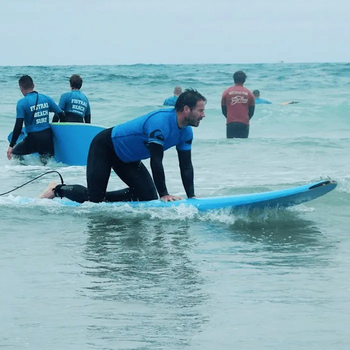 Surf Instructor on a surf board