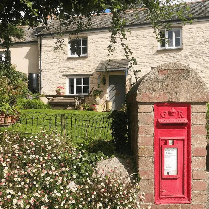 a house with a post box outside