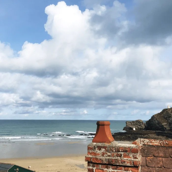 Portreath Beach with a chimney in the foreground
