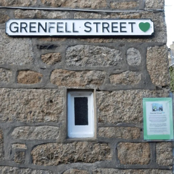 Grenfell Street sign and tribute in Mousehole