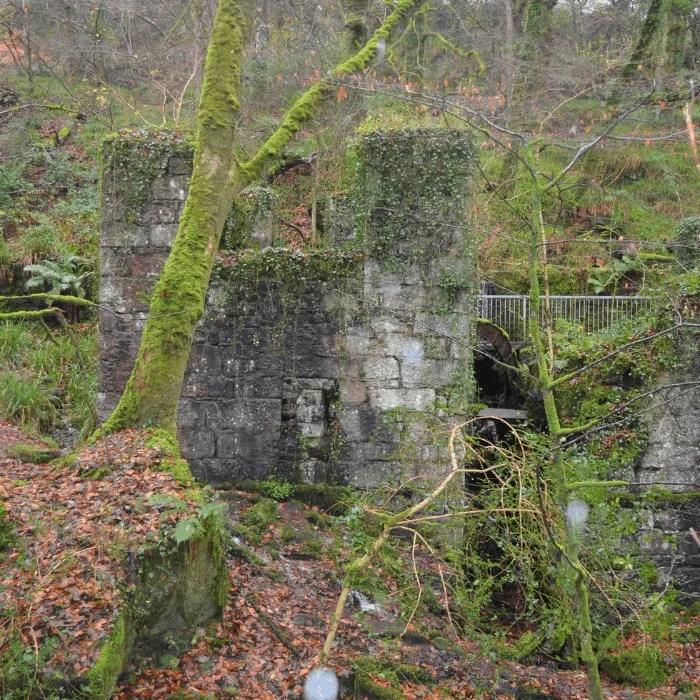A derelict gunpowder mill at Kennall Vale