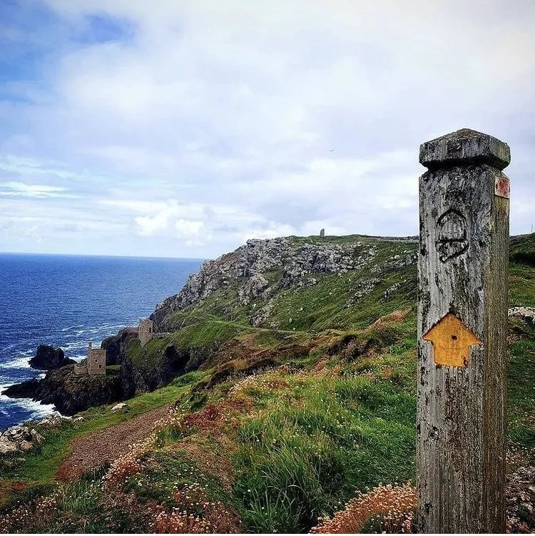 A south west coast path sign and Botallack Tin Mine