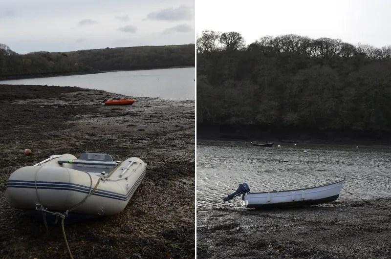 Muddy banks at Percuil River at low tide, with small boats