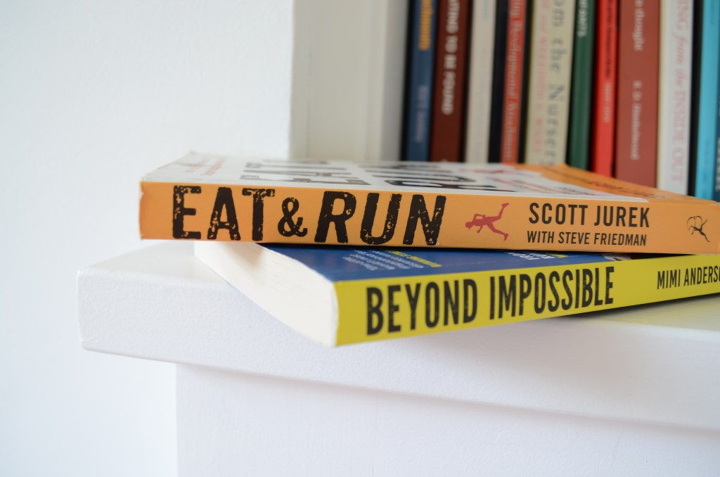 Eat and Run and Beyond Impossible on a bookshelf