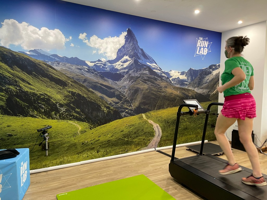 Woman running on a treadmill at THe Run Lab