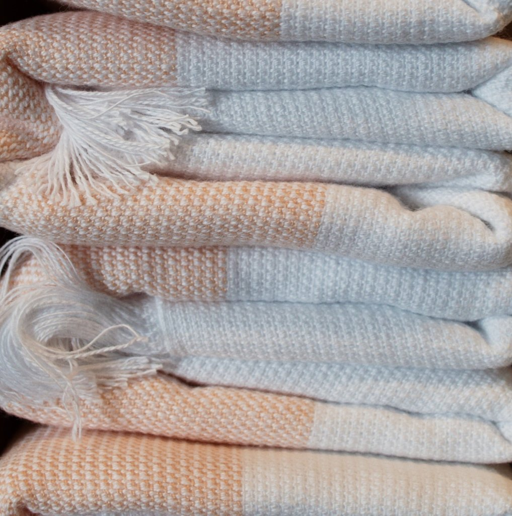 a pile of pink and white hammam towels