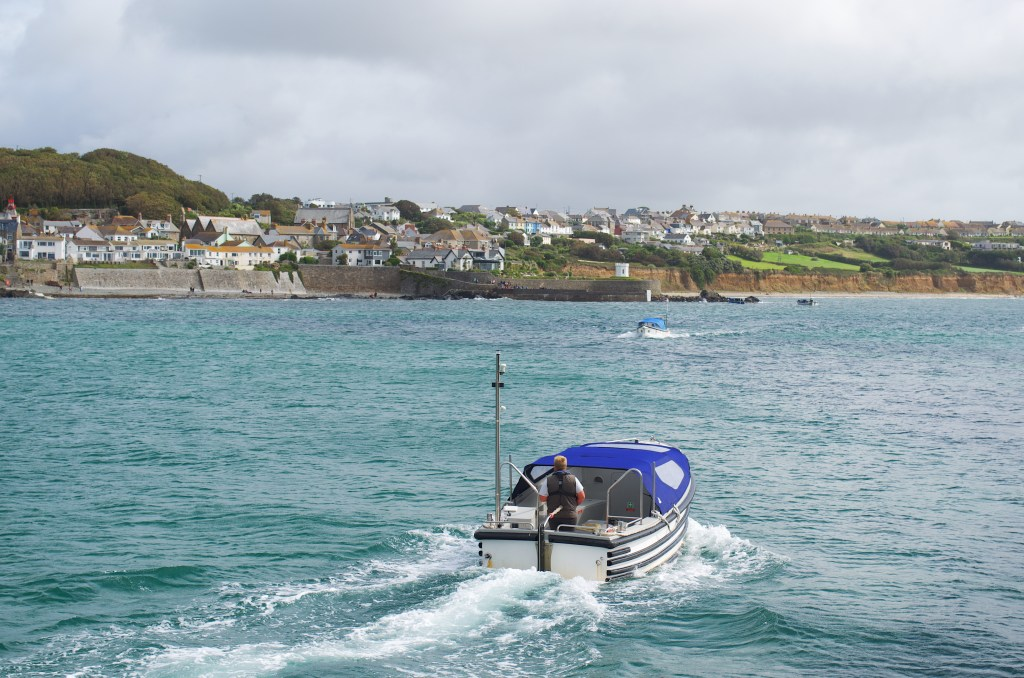 A speedboat motoring on the sea from St Michael's Mount to Marazion Cornwall
