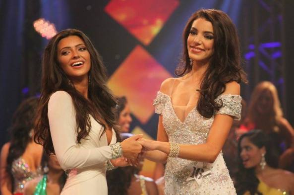 Ashleigh Lollie, left, and Kailyn Perez held hands before the announcement of the winner at finals for the Miss Florida USA 2015