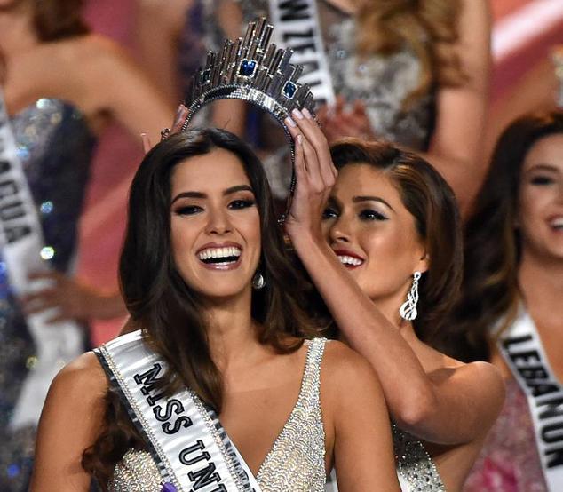 Miss Universe 2013 Maria Gabriela Isler of Venezuela crowning her successor Colombia's Paulina Vega