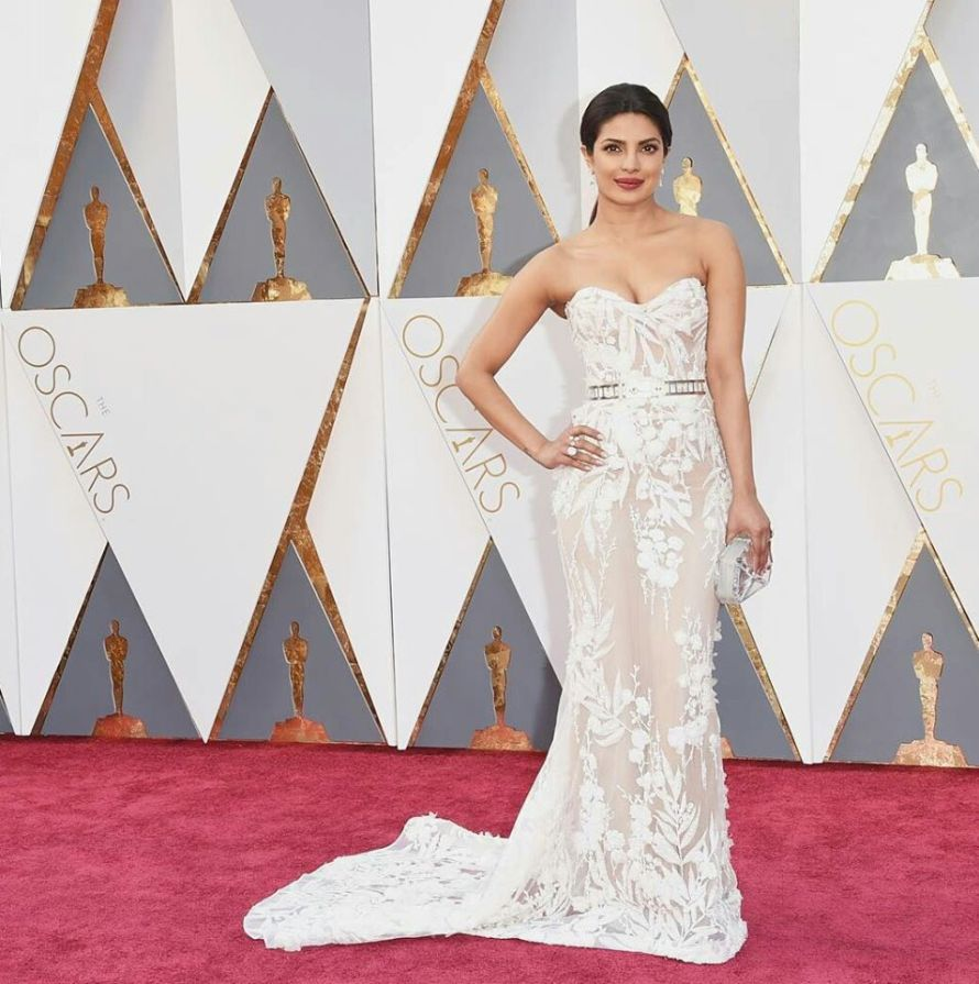 Priyanka Chopra at the Oscars 2016 looked stunning in a white Zuhair Murad gown