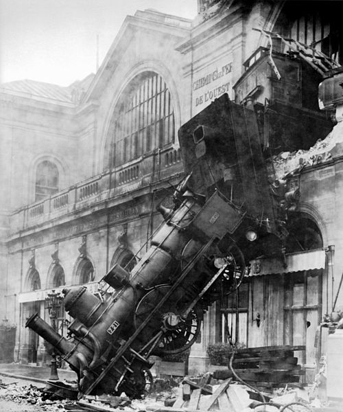 """Trumponomics ends in a train wreck? (Photo credited to the firm Levy & fils by this site. (It is credited to a photographer """"Kuhn"""" by another publisher [1].) (the source was not disclosed by its uploader.) [Public domain], via Wikimedia Commons)"""