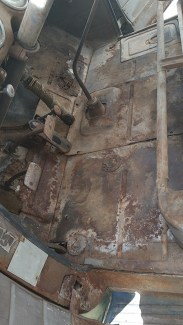 Toe panel and floor, stripped of a couple layers of fossilized floor mats and dirt.
