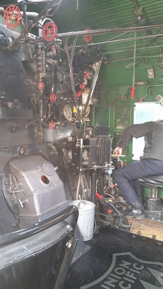 The right-hand-drive cab of a working steam locomotive. Every knob and lever works.