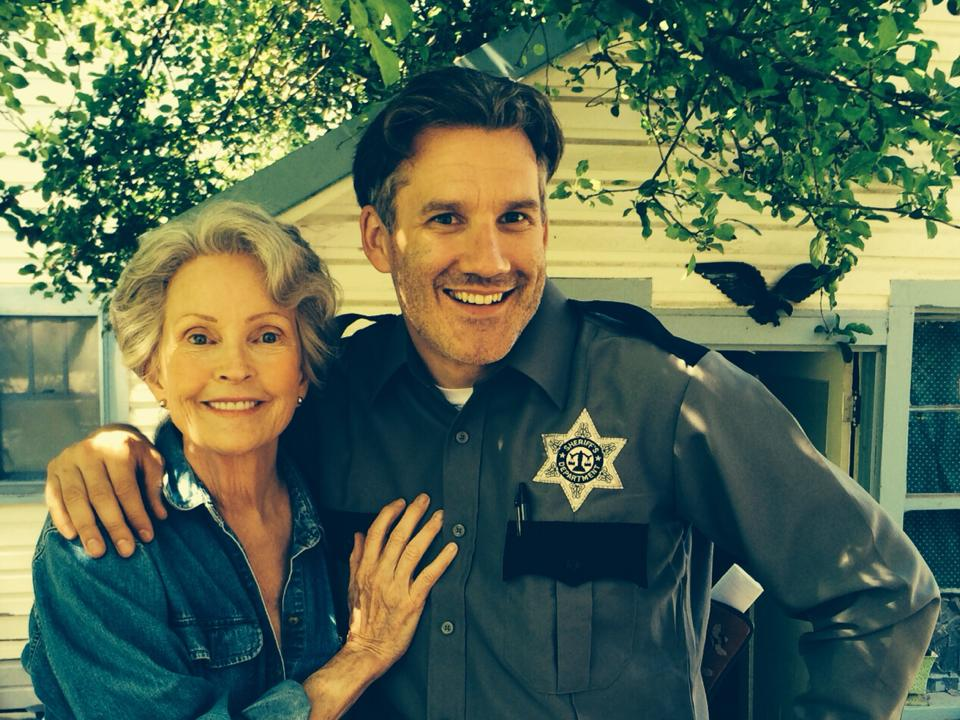 Greg James (as the Sheriff) posing with Marlyn Mason (Mildred)