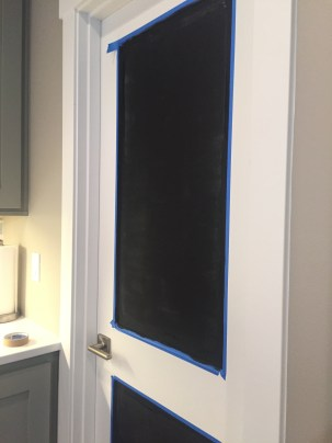 Door taped with first coat of paint.