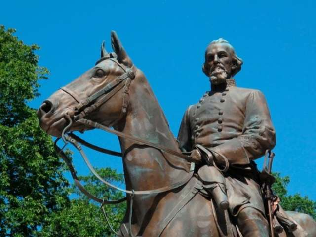 In this Aug. 18, 2017, photo, a statue of Confederate Gen. Nathan Bedford Forrest sits in a park in Memphis, Tenn. A city council in Tennessee plans to consider four different ways to deal with the growing uproar over the existence of two statues of Confederate leaders at city parks. Council members in Memphis agreed Tuesday, Aug. 22, to discuss a resolution listing steps it can take to remove or board up statues of Jefferson Davis and Nathan Bedford Forrest. (AP Photo/Adrian Sainz, File)