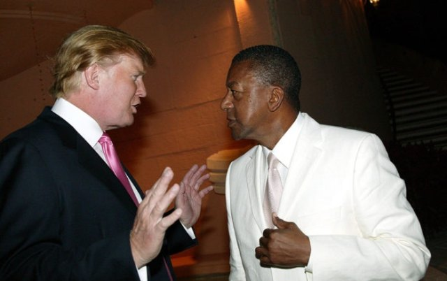 Donald Trump and Bob Johnson during Art for Life Gala Honoring Sean P. Diddy Combs Hosted by Russell Simmons and Kimora Lee Simmons at Mar-a-Lago in Palm Beach, Florida March 11, 2005. (Photo by Johnny Nunez/WireImage) thegrio.com