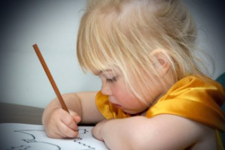 Little girl writing a letter - discussing the scary stuff with your child