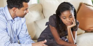 Raise Your Child's Self-Esteem - Father and daughter talking